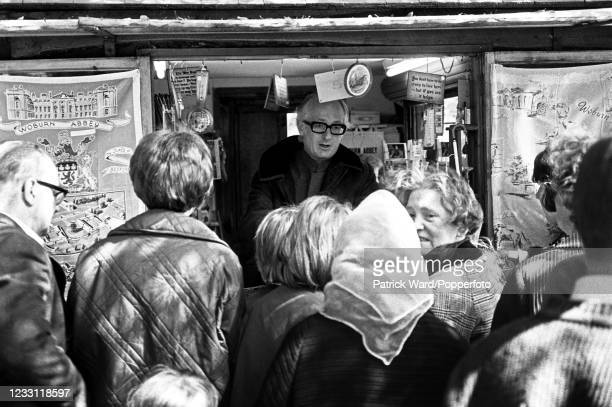 Ian Russell, the 13th Duke of Bedford, selling ice cream and tea towels from a kiosk at his family seat, Woburn Abbey in Bedfordshire, circa July...
