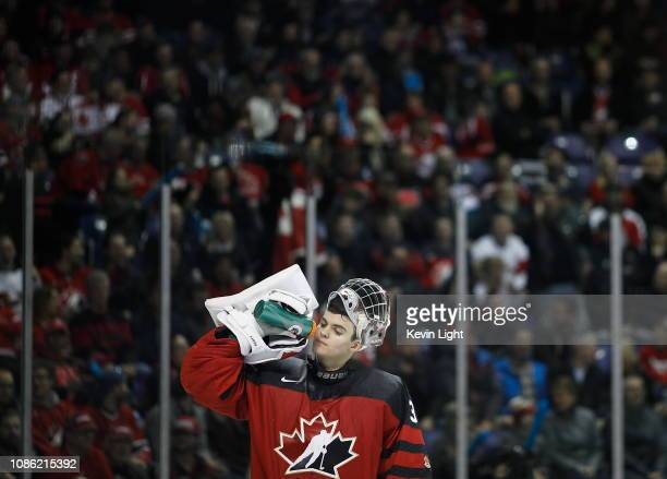 Ian Scott of Team Canada drinks from his water bottle versus Team Slovakia at the IIHF World Junior Championships at the SaveonFoods Memorial Centre...