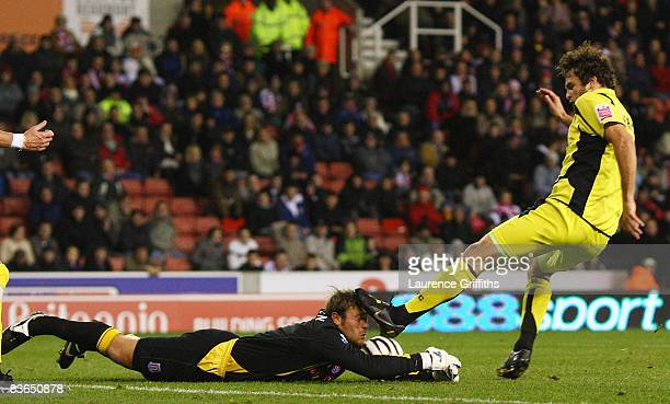 Ian Sharps of Rotherham United battles with Steve Simonsen of Stoke during the Carling Cup Fourth Round match between Stoke City and Rotherham United...