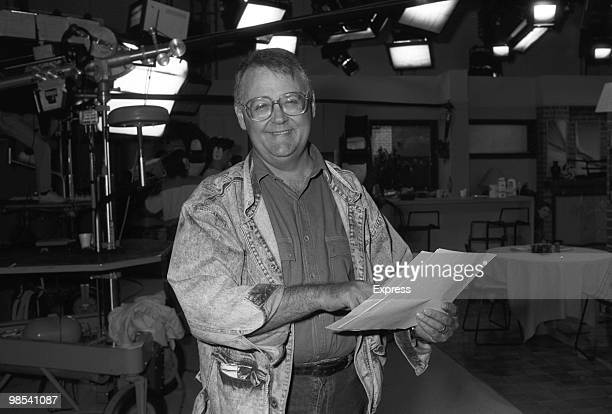Ian Smith, actor, as Harold Bishop in Australian soap opera Neighbours smiling while holding a script. Australia, 20th October 1988.