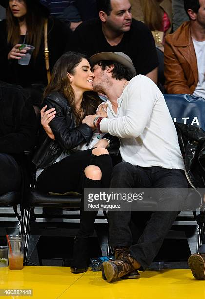 Ian Somerhalder and Nikki Reed kiss at a basketball game between the Phoenix Suns and the Los Angeles Lakers at Staples Center on December 28, 2014...