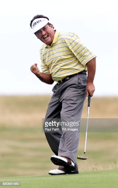Ian Stanley of Australia celebrates after holing a birdie put at the 16th hole in the Senior British Open Golf Championship at Royal County Down...