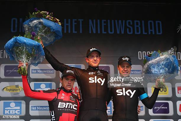 Ian Stannard of Great Britain and Team Sky celebrates first place alongside second placed Greg Van Avermaet of Belgium and BMC Racing Team and third...