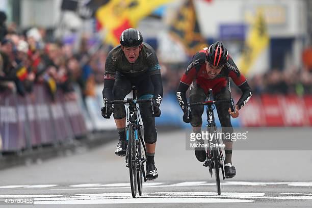 Ian Stannard of Great Britain and Team Sky claims victory from Greg Van Avermaet of Belgium and BMC Racing Team during the Omloop Het Nieuwsblad on...