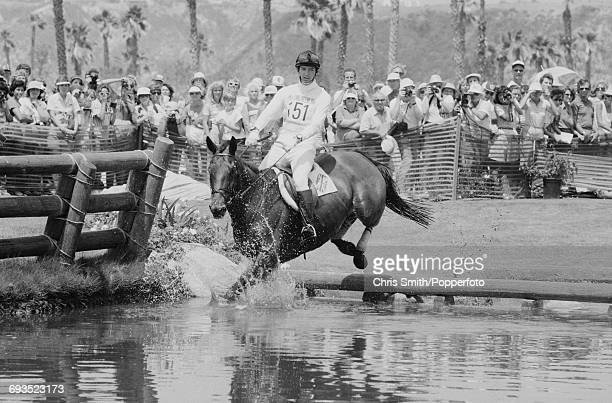 Ian Stark of Great Britain rides his horse Oxford Blue through water in the Cross Country discipline of the Three Day Team Eventing competition at...