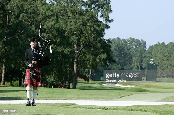 Ian Staten pays tribute to Payne Stewart as he walks up the 1st hole playing the bagpipes prior to the start of the US Open on June 14 2005 at the...