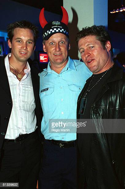 APRIL 2002 Ian Stenlake Real life policeman senior constable Simon Gallant and Peter Phelps The party for the launch of the new Virgin Megastor in...