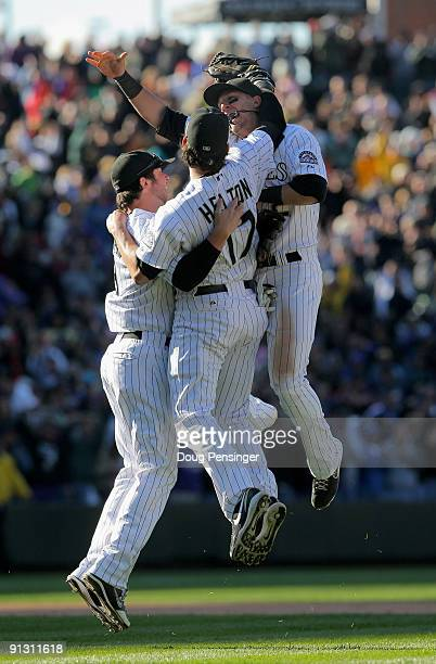 Ian Stewart Todd Helton and Troy Tulowitzki of the Colorado Rockies celebrate after the final out as they defeated the Milwaukee Brewers 92 and...