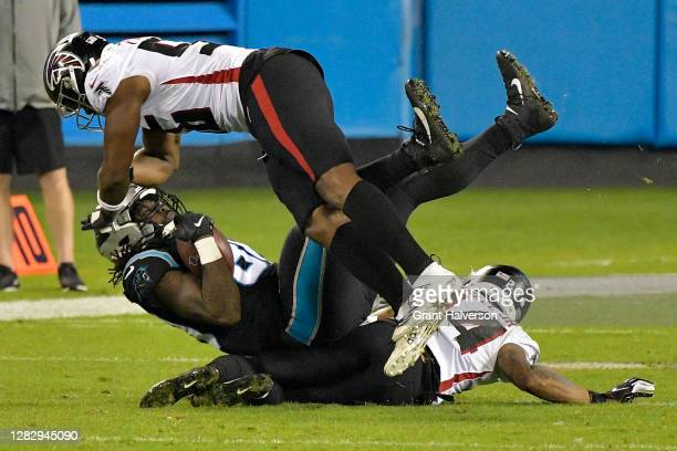 Ian Thomas of the Carolina Panthers is tackled by Dante Fowler Jr. #56 and Foye Oluokun of the Atlanta Falcons during the fourth quarter at Bank of...