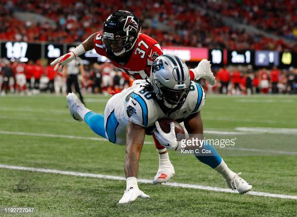 Ian Thomas of the Carolina Panthers pulls in this touchdown reception against Ricardo Allen of the Atlanta Falcons in the first half at Mercedes-Benz...