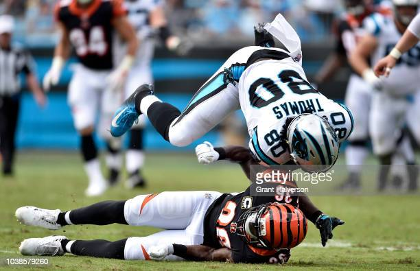 Ian Thomas of the Carolina Panthers runs the ball against Shawn Williams of the Cincinnati Bengals in the second quarter during their game at Bank of...