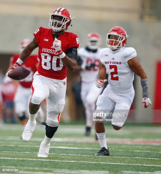 Ian Thomas of the Indiana Hoosiers runs the ball for a touchdown against the Rutgers Scarlet Knights at Memorial Stadium on November 18 2017 in...
