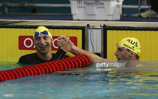 Ian Thorpe of Australia celebrates with Grant Hackett of Australia after winning gold and both breaking the world record in the Men's 400M Freestyle...