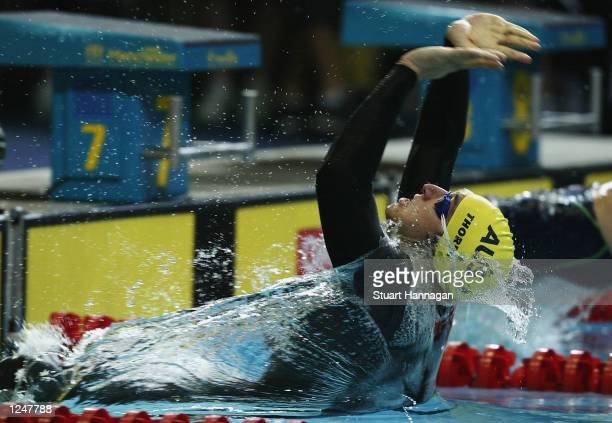 August 3: Ian Thorpe of Australia leaves the start in the Men's 100M Backstroke swimming Final from the Manchester Aquatics centre during the 2002...