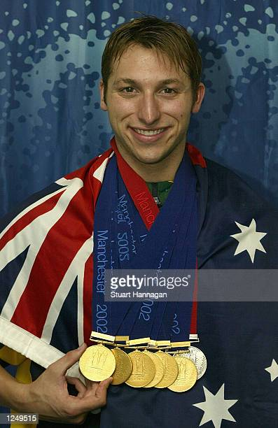 Ian Thorpe of Australia poses with the six gold medals and one silver medal he won during the 2002 Commonwealth Games Manchester England on August 5...