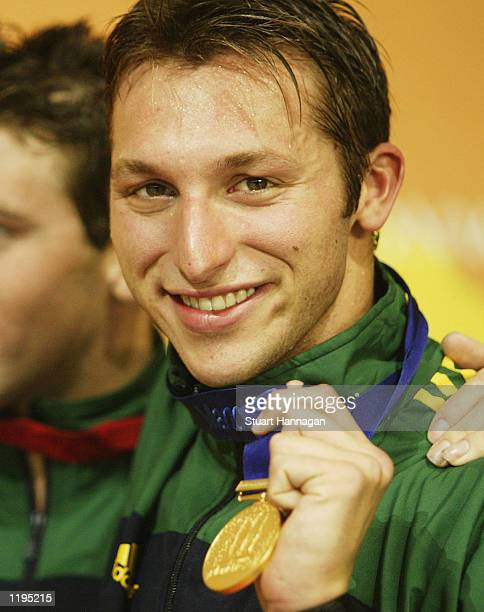 Ian Thorpe of Australia with his gold medal after breaking the world record in the Men's 400M Freestyle final from the Manchester Aquatics centre...