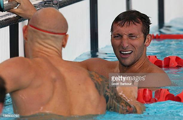 Ian Thorpe of New South Wales checks his time on the scoreboard as Michael Klim looks at him after swimming in the Mens 100 Meter Freestyle at the...