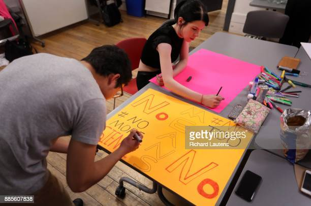 Ian Tian and Kristi Magdalene work on signs for the march Alathea MilneHines is the lead organizer of the Me Too march in Toronto She and other...