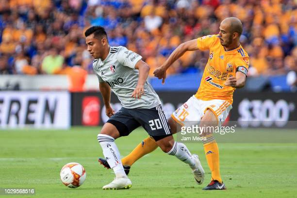 Ian Torres of Atlas fights for the ball with Guido Pizarro of Tigres during the 6th round match between Tigres UANL and Veracruz as part of the...