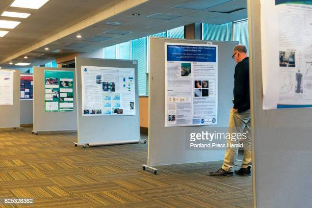 Ian Tuck a scientist from New Zealand's National Institute of Water and Atmospheric Research peruses abstracts from research papers that are designed...