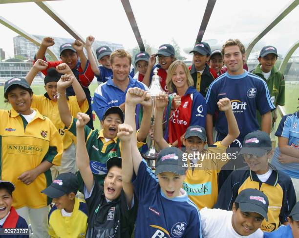 Ian Ward, Clare Connor and James Benning pose with school children during the Twenty20 Cup Launch at Lords Cricket Ground on June 18, in London.