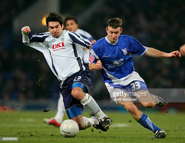 Ian Westlake of Ipswich is challenged by Richard Hughes of Portsmouth during the FA Cup third round match between Ipswich Town and Portsmouth at...