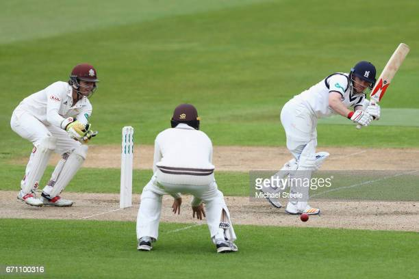 Ian Westwood of Warwickshire plays to the legside as wicketkeeper Ben Foakes of Surrey looks on during day one of the Specsavers County Championship...