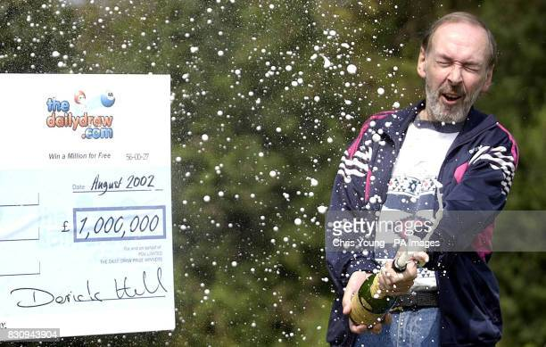 Ian White from Grays in Essex celebrates after winning 1 million on the internet lottery site 'thedailydrawcom' Mr White who is disabled with...