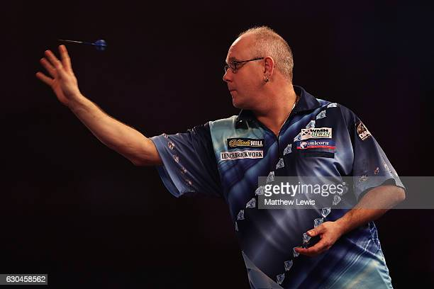 Ian White of Great Britain in action agasint Jonny Clayton of Great Britain during day nine of the 2017 William Hill PDC World Darts Championships at...