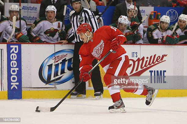 Ian White of the Detroit Red Wings shoots during their NHL game against the Minnesota Wild at Joe Louis Arena on March 20 2013 in Detroit Michigan