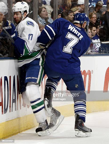 Ian White of the Toronto Maple Leafs runs into Ryan Kesler of the Vancouver Canucks during game action January 30 2010 at the Air Canada Centre in...