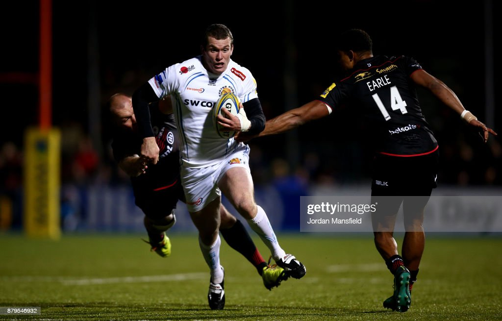 Ian Whitten of Exeter avoids a tackle from Schalk Burger of Exeter during the Aviva Premiership match between Saracens and Exeter Chiefs at Allianz Park on November 26, 2017 in Barnet, England.