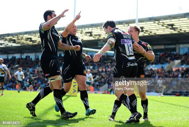 Ian Whitten of Exeter Chiefs celebrates his side's third try during the Aviva Premiership match between Exeter Chiefs and Northampton Saints at Sandy...
