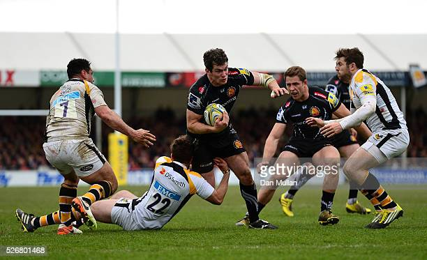 Ian Whitten of Exeter Chiefs is tackled by Ruaridh Jackson of Wasps during the Aviva Premiership match between Exeter Chiefs and Wasps at Sandy Park...