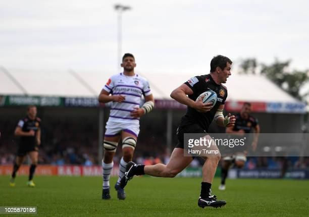 Ian Whitten of Exeter Chiefs runs in to go over for a try during the Gallagher Premiership Rugby match between Exeter Chiefs and Leicester Tigers at...
