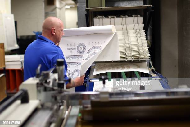 Ian Williams oversees the print work for the production of special edition crockery ahead of the wedding of Prince Harry and Meghan Markle at William...