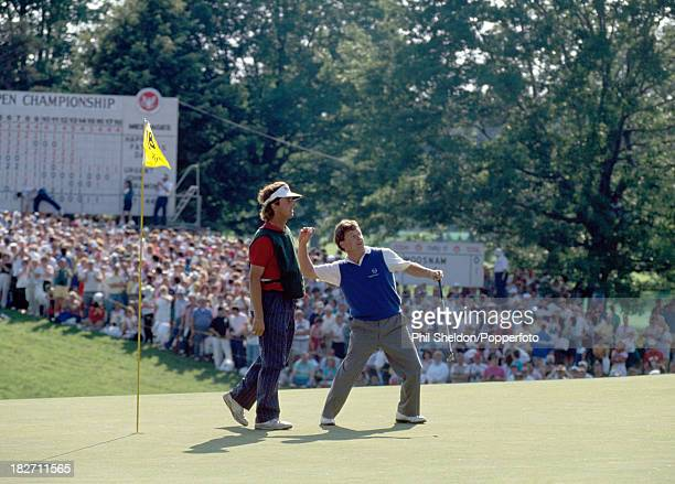 Ian Woosnam of Great Britain acknowledges the crowd with his caddie during the US Open Golf Championship held at the Oak Hill Golf Club New York 18th...