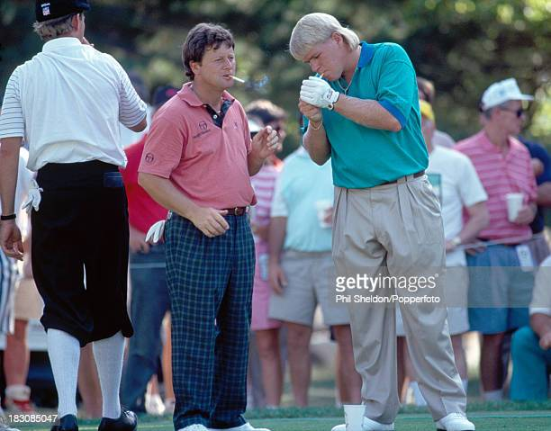 Ian Woosnam of Great Britain and John Daly of the United States smoking cigarettes during the US Open Golf Championship held at the Baltusrol Golf...