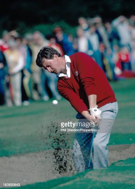 Ian Woosnam of Great Britain chipping out of a bunker during the Benson and Hedges International Open Golf Tournament held at the Fulford Golf Club...