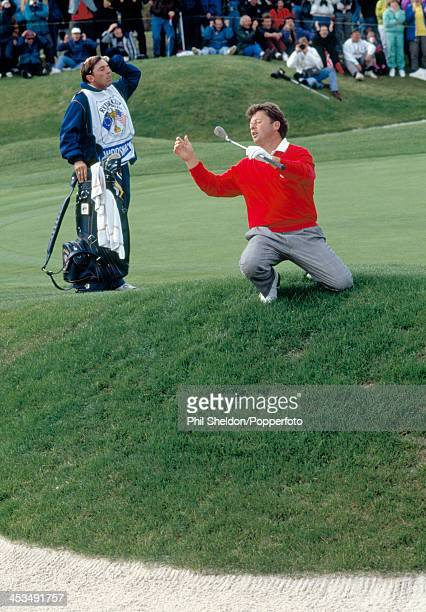 Ian Woosnam of the European team reacts after narrowly missing the hole during the Ryder Cup golf competition held at The Belfry Warwickshire 26th...