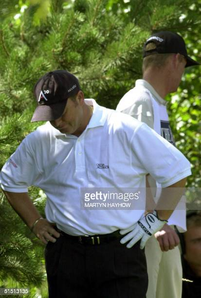 Ian Woosnam of Wales cannot face looking at his caddie, Miles Byrne,behind, at the 2nd tee of Open Golf Championship at Royal Lytham & St Annes...