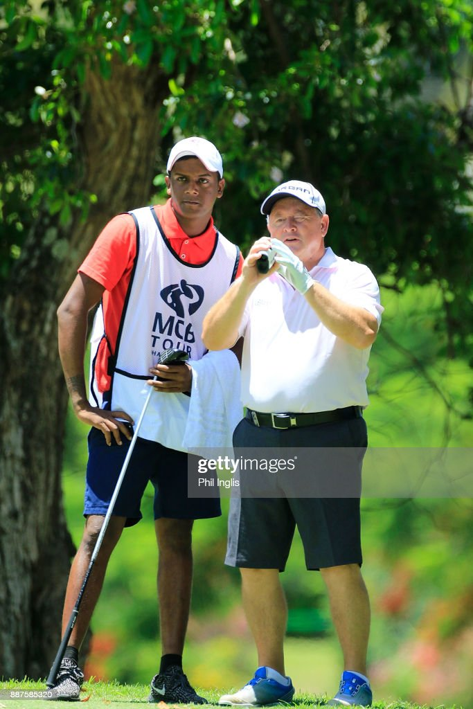 Ian Woosnam of Wales discusses with his caddie, the line of his drive from the 10th tee during the ProAm ahead of the first round of the MCB Tour Championship played over the Legend Course at Constance Belle Mare Plage on December 7, 2017 in Port Louis, Mauritius.