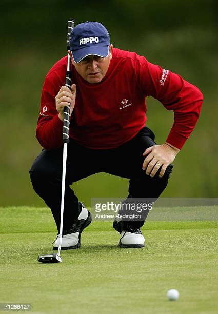 Ian Woosnam of Wales lines up his putt on the first hole during the first round of The Johnnie Walker Championship on The PGA Centenary Course at...