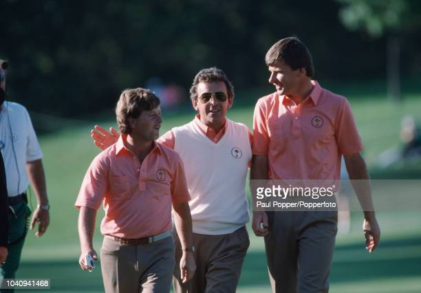 Ian Woosnam of Wales walks with captain Tony Jacklin and Nick Faldo of England during play for Team Europe against Team USA in the 1987 Ryder Cup at...