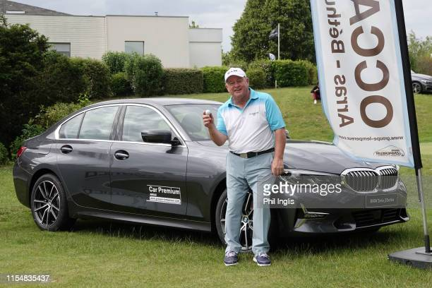 Ian Woosnam of Wales with his hole in one prize a BMW car for holing his tee shot on the 10th hole during the final round of the Open Senior Houts de...