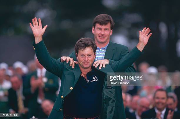 Ian Woosnam receives the green jacket from Nick Faldo after winning the 1991 Masters tournament at Augusta National Club 1st May 1991
