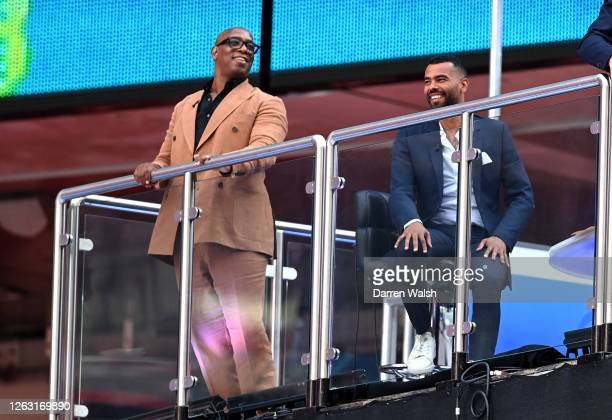 Ian Wright and Ashley Cole are seen in the TV studio inside the stadium during the Heads Up FA Cup Final match between Arsenal and Chelsea at Wembley...