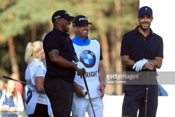 Ian Wright and Jamie Redknapp share a joke during the BMW PGA Championship ProAm at Wentworth Golf Club on September 18 2019 in Virginia Water United...