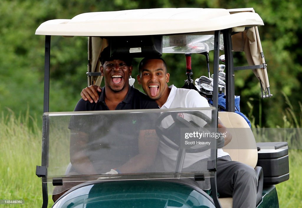 Ian Wright (L) and Theo Walcott during a Vauxhall Golf Day for the England Football team at The Grove Hotel on May 30, 2012 in Hertford, England.