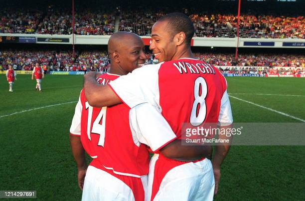 Ian Wright and Thierry Henry of Arsenal exchange shirts before the Martin Keown Testimonial between Arsenal and World XI on May 17, 2004 at Arsenal...